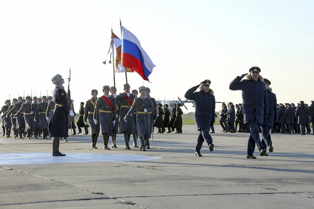 Servicemen take part in a ceremony to welcome Russian military aircraft and pilots after they arrived from Syria, at an airbase in Krasnodar region, southern Russia, in this March 16, 2016 handout photo by the Russian Ministry of Defence. (Photo by Olga Balashova/Reuters/Russian Ministry of Defence)