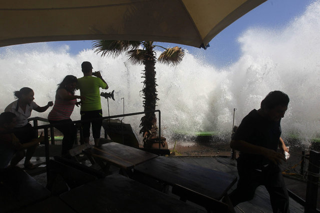 Large waves crash into a beachside restaurant in Puerto La Libertad, some 30 km south of San Salvador, El Salvador, 03 May 2015. The Minister of Environmental and Natural Resources of El Salvador said that most of the Salvadorean Pacific coast was badly damaged due to strong waves recorded in the last hours. EPA/Oscar Rivera ES02  (Oscar Rivera / EPA)