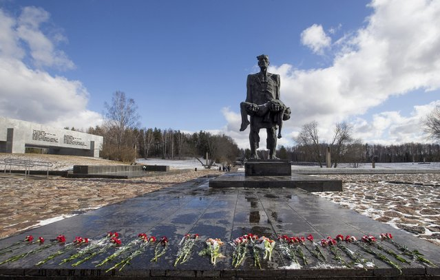 A World War Two memorial is seen in the former village of Khatyn, northeast of Minsk, March 22, 2015. Nazi troops killed 149 villagers on March 22, 1943, most of them children and women, and burned down their houses and the village was never restored again, according to historians. (Photo by Vasily Fedosenko/Reuters)