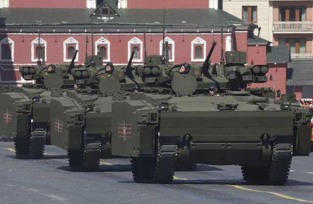 Russian servicemen drive Kurganets-25 infantry fighting vehicles during a rehearsal for the Victory Day parade in Red Square in central Moscow, Russia, May 7, 2015. (Photo by Sergei Karpukhin/Reuters)
