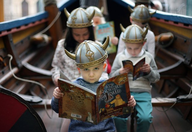 Cillian O'Rourk, three, at the Dublinia exhibition centre in Dublin, on February 18, 2014, for the launch of World Book Day which takes place in Ireland on March 6th. (Photo by Niall Carson/PA Wire)
