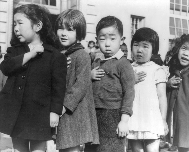 First-graders, some of Japanese ancestry, pledge allegiance to the American flag at the Weill public school in San Francisco, April 1942. (Photo by Dorothea Lange/Library of Congress/Reuters)