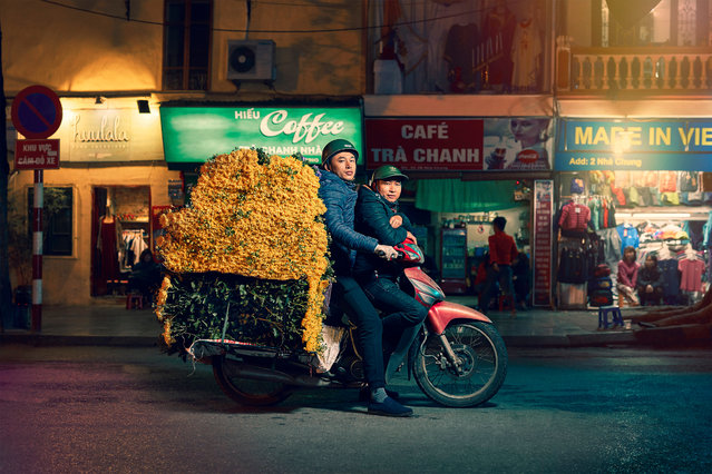 "From footballs to live fish, delivery mopeds piled high with unwieldy, unlikely goods are one of the Vietnamese capital's most distinctive sights. As the city plans to ban motorbikes altogether, photographer Jon Enoch captured the drivers at work. Here: Flowers. ""When I first travelled around south-east Asia 15 years ago, the motorbikes and mopeds just astounded me"", photographer Jon Enoch says. (Photo by Jon Enoch/The Guardian)"