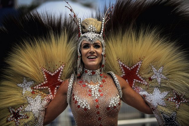 "A member of Brazilian samba school ""Aguia de Ouro"" takes part in a parade at Anhembi sambadrome as part of carnival in Sao Paulo, Brazil, early 25 February 2017. The Sao Paulo Carnival runs from 24 to 28 february 2017. (Photo by Fernando Bizerra Jr./EPA)"