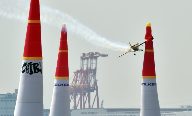 French pilot Francois Le Vot of Breitling Racing hits a pylon, which forms an air gate, during round 14 Master Class competitions at the Red Bull Air Race Chiba, one of the 2015 Red Bull Air Race World Championship series, in Makuhari, Chiba prefecture on May 17, 2015. (Photo by Kazuhiro Nogi/AFP Photo)