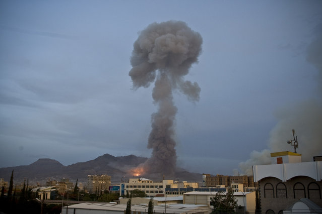 Smoke rises after a Saudi-led airstrike hit a site believed to be a munitions storage, in Yemen's capital, Sanaa, on Monday, May 11, 2015. (Photo by Hani Mohammed/AP Photo)