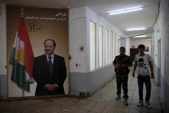 A big poster of Massoud Barzani president of the Iraqi Kurdistan is seen inside the peshmerga base in Makhmour, after it was freed from control of Islamic State, south of Mosul, April 17, 2016. (Photo by Ahmed Jadallah/Reuters)