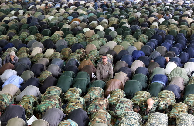 Members of Iranian army and revolutionary guards corps (IRGC), pray during a weekly Friday Prayer ceremony in Tehran, Iran, 12 April 2019. Media reported Iranian Ayatollah Ali Mowahedi Kermani threats Israel as saying in his speech that, 'Mr. Trump don't play with lion tail' (referring to US government on 08 April 2019 said it had designated Iran's revolutionary guards corps (IRGC) as a terrorist organization), the IRGC could destroy Israel with its missiles. (Photo by Abedin Taherkenareh/EPA/EFE)