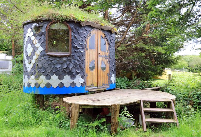 Love Shack – owned by Grant Oatley in Devon The Love Shack is a tiny little work of art that you could live in while also being completely transportable after being built on its own trailer. It's clad with tiles made from reclaimed tractor inner tubes, and has a living roof. (Photo by Cuprinol/Rex Features/Shutterstock)