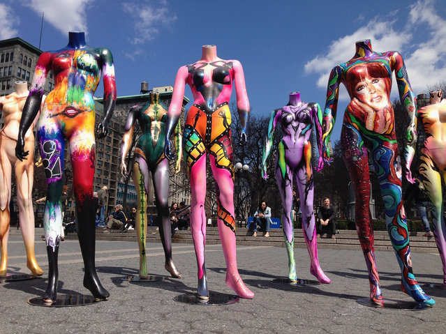 A dozen mannequins stand on display on a sunny spring day in Union Square on April 9, 2014 in New York City. The display, called #MakeupArtForever, was set up throughout Manhattan to celebrate the 30th anniversary of the Make Up Forever brand. (Photo by John Moore/Getty Images)