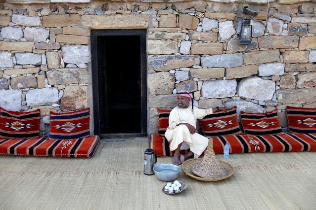 An Emirati man sits outside an old house at the Heritage Village in Dubai, UAE March 13, 2016. (Photo by Ahmed Jadallah/Reuters)