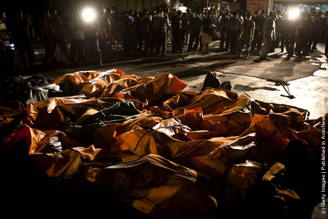 Victims from last week's boat sinking off the coast of Indonesia are unloaded by Indonesian Navy sailors