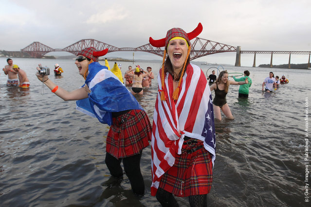 New Year revellers, many in fancy dress, braved freezing conditions in the River Forth in front of the Forth Rail Bridge during the annual Loony Dook Swim