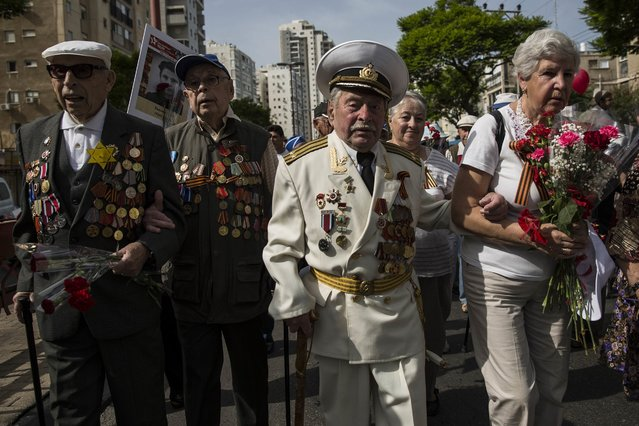 Russian World War II veterans who fought for the Soviet Union take part in a march marking the 70th anniversary of the Allied victory over the Nazi Germany in 1945, in the port city of Ashdod, Monday, May 9, 2016. (Photo by v/AP Photo)