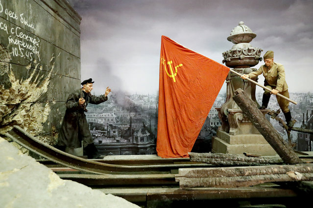 "A scene showing the hoisting of the Soviet flag on top of the Reichstag building after the ""Battle of Berlin"" (02 May 1945) is prepared for the opening of the 3D Panorama exhibition titled ""Memory talks. The road through war"" in an exhibition hall of the former Sevcabel port in St. Petersburg, Russia, 16 September 2019. (Photo by Anatoly Maltsev/EPA/EFE)"