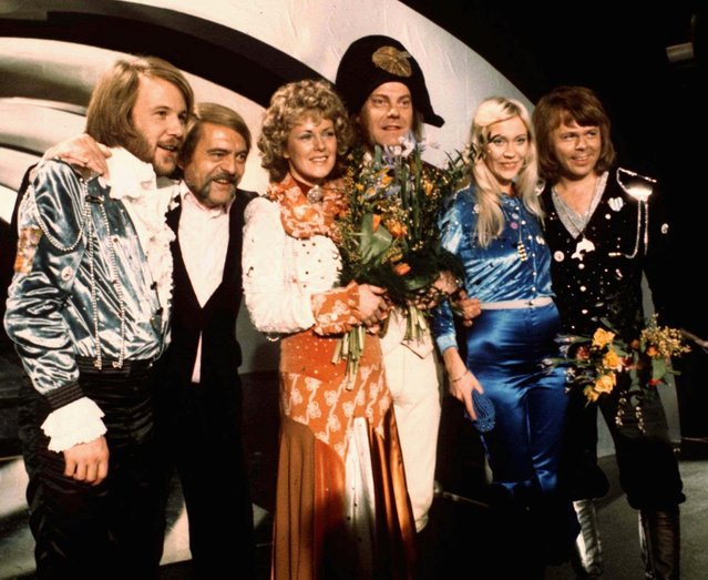 "In this April 6, 1974 file photo, members of Swedish group ABBA and close associates celebrate the victory of their song ""Waterloo"" in the Eurovision Song Contest in Brighton, England. The four members of ABBA, Benny Andersson, left, Annifrid Lyngstad, third left, Agnetha Faltskog, second right, and Bjorn Ulvaeus, right, , second right, were the most successful winners of the Eurovision Song Contest, enjoying unprecedented success after their victory. The final of this year's competition takes place on Saturday, May 14 in the Swedish capital Stockholm. (Photo by AP Photo)"