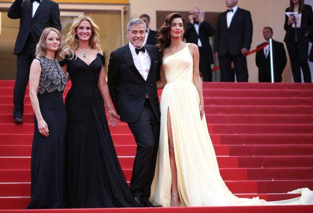 Director Jodie Foster, from left, actors Julia Roberts, George Clooney and Amal Clooney pose for photographers for the screening of the film Money Monster at the 69th international film festival, Cannes, southern France, Thursday, May 12, 2016. (Photo by Thibault Camus/AP Photo)