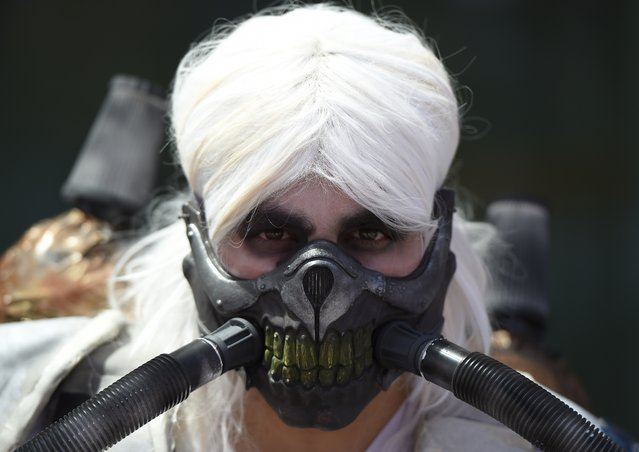An attendee in costume is seen on the third day of Comic Con International in San Diego, California, July 11, 2015. (Photo by Robyn Beck/AFP Photo)