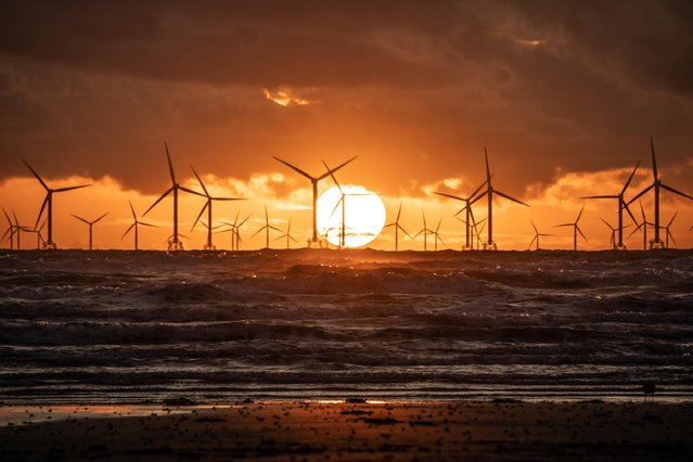The sun sets on Walney Island, Cumbria, county in North West England on October 10, 2019. Today will be unsettled with spells of heavy rain. (Photo by GREENBURN/Alamy Live News)