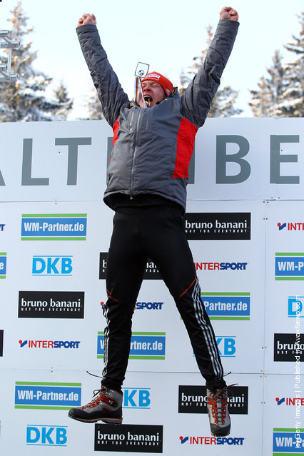Felix Loch of Germany celebrates after he wins the gold medal during the men's single run in the Luge World Championship