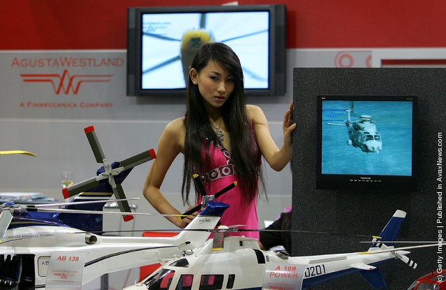 A Chinese model promotes a foreign helicopter company during the 11th Beijing Aviation Expo