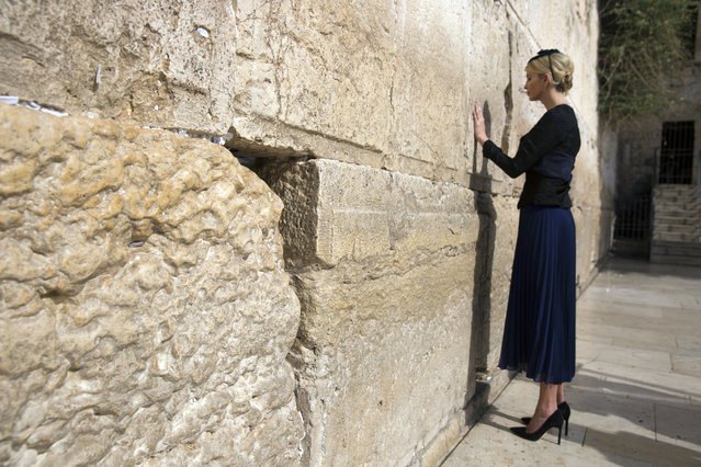 Ivanka Trump, assistant and daughter of US President Donald J. Trump, touches the Western Wall, Judaism's holiest prayer site, in Jerusalem's Old City, 22 May 2017. President Trump and his contingent arrived for a 28-hour visit to Israel and the Palestinian Authority areas on his first foreign trip since taking office in January. (Photo by Heidi Levine/EPA)
