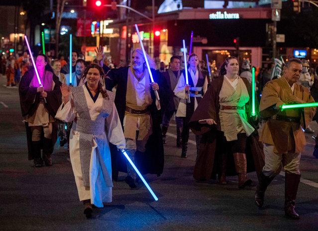 People dressed as Star Wars characters march during the 88th annual Hollywood Christmas Parade in Hollywood, California on December 1, 2019. (Photo by Mark Ralston/AFP Photo)