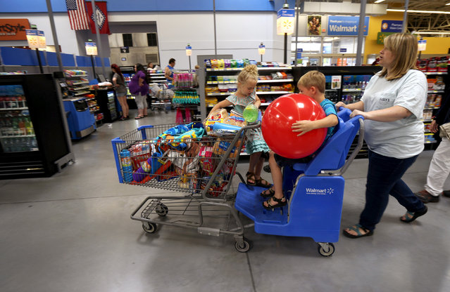 A family shops at the Wal-Mart Supercenter in Springdale, Arkansas June 4, 2015. Wal-Mart will hold its annual meeting June 5, 2015. (Photo by Rick Wilking/Reuters)