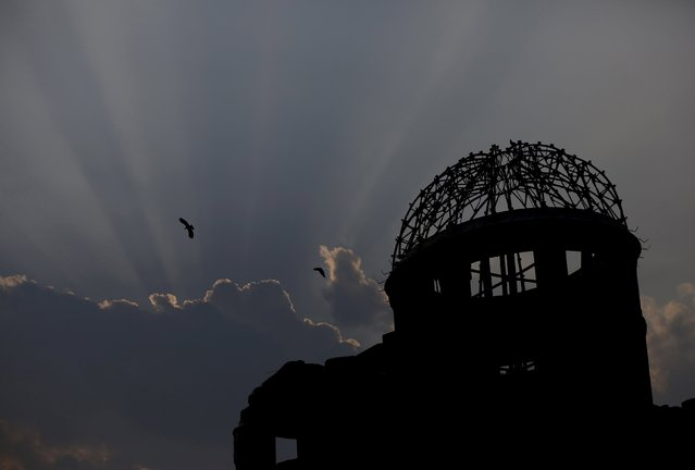 Birds fly over the Atomic Bomb Dome in Hiroshima, western Japan July 29, 2015. On August 6, 1945, the U.S. dropped the atomic bomb on Hiroshima, killing about 140,000 by the end of the year in a city of 350,000 residents, in the world's first nuclear attack. (Photo by Issei Kato/Reuters)