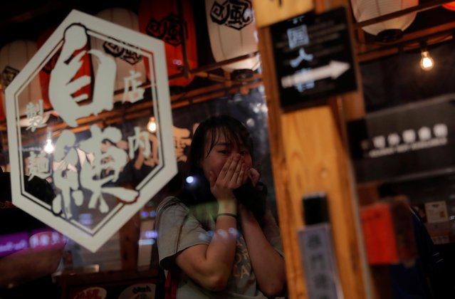 A woman reacts as riot police clashes with anti-government protesters inside a bar in Wan Chai district, Hong Kong, China, September 29, 2019. (Photo by Susana Vera/Reuters)