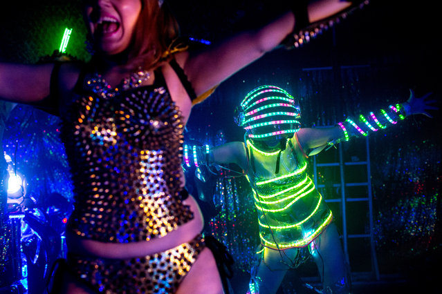 Dancers dressed as futuristic characters perform during a show at The Robot Restaurant on June 29, 2014 in Tokyo, Japan. The now famous Robot Restaurant opened two years ago in Kabukicho area of Shinjuku at an estimated cost of 10 million U.S. dollars. (Photo by Chris McGrath/Getty Images)