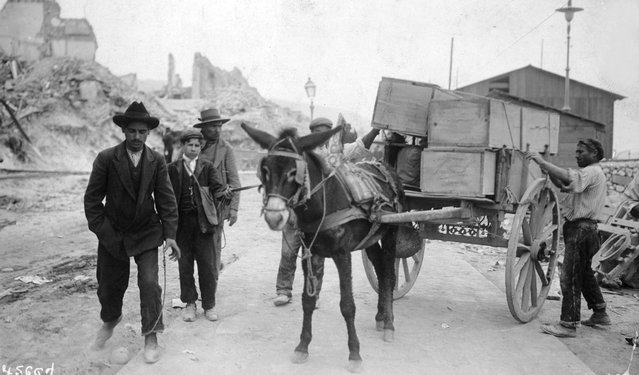 A donkey cart carrying coffins containg the dead from the earthquake at Messina, 9th April 1909. (Photo by Hulton Archive/Getty Images)