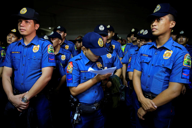 """Members of the Philippine National Police stand at attention before operation """"Rid the Streets Of Drinkers and Youth"""" in Las Pinas city, metro Manila, Philippines June 1, 2016. (Photo by Romeo Ranoco/Reuters)"""