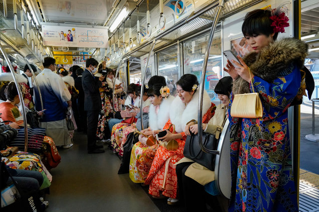 Young Japanese women dressed in colorful kimonos sit inside a train car after attending a ceremony marking the Coming of Age Day at Toshimaen Amusement Park in Tokyo, Japan, 13 January 2020. (Photo by Christopher Jue/EPA/EFE)