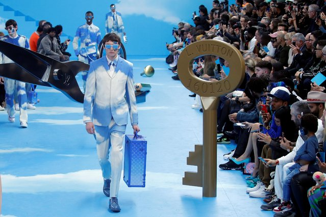 Models present creations by designer Virgil Abloh as part of his Fall/Winter 2020 collection show for fashion house Louis Vuitton during Men's Fashion Week in Paris, France, January 16, 2020. (Photo by Charles Platiau/Reuters)
