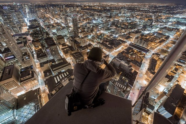 """""""Tonight, this is your city"""". (Photo by Roof Topper)"""