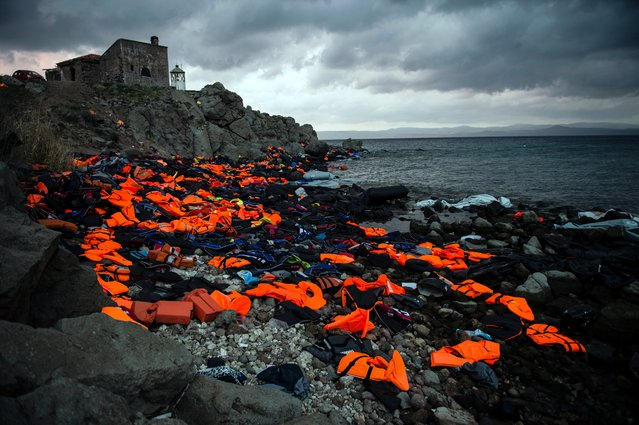 "The Ciwem changing climate award 2016 is presented to Sandra Hoyn for her moving photograph ""Life Jackets on the Greek Island of Lesbos"". Hoyn, a German photojournalist, concentrates on social, environmental and human rights issues. Her winning photograph depicts the discarded life vests used by refugees to cross to Greece from Turkey, and hints at the enormity of the crises and dangers faced by the refugees. (Photo by Sandra Hoyn/2016 EPOTY)"