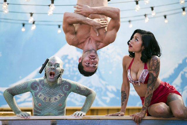 "Circus performers, The Lizard Man (L), Danik Abishev (C) and Heather Holliday pose for a photograph in the ""London Wonderground"" at the Southbank Centre on July 24, 2014 in London, England. The temporary 'London Wonderground' venue, located adjacent to the London Eye and the Royal Festival Hall, offers a programme of live entertainment, fairground rides and outdoor bars and runs until September 28, 2014. (Photo by Oli Scarff/Getty Images)"