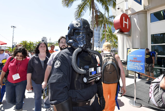 Fans wait in line outside of Hall H on day 1 of the 2014 Comic-Con International Convention held Thursday, July 24, 2014 in San Diego. (Photo by Denis Poroy/Invision/AP Photo)