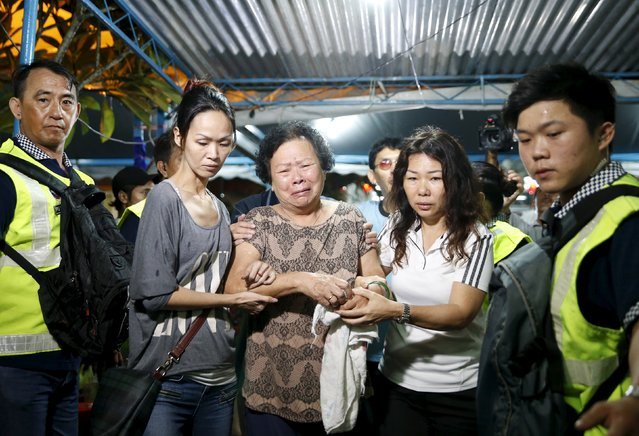 A family member of Neoh Hock Guan, a survivor of Monday's blast in Bangkok, arrives to pay her last respects to his wife and son who were killed in the attack in Butterworth, Malaysia, August 20, 2015. (Photo by Olivia Harris/Reuters)