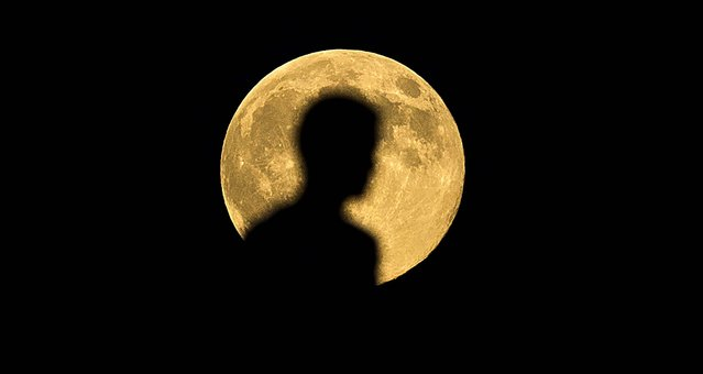 A man is silhouetted by the Supermoon in Madrid. (Photo by Andres Kudacki/Associated Press)