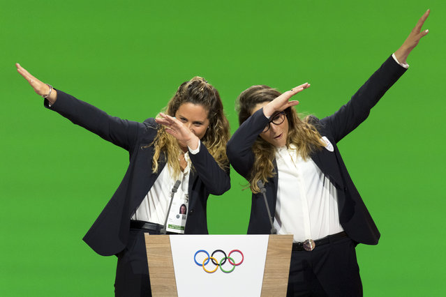 In this Monday, June 24, 2019 filer, Italian snowboarder Michela Moioli, left, and Italian skier Sofia Goggia, right, dab after speaking during the presentation of the Milan-Cortina candidate cities the first day of the 134th Session of the International Olympic Committee (IOC), in Lausanne, Switzerland. Eight months later Goggia and Moioli feel like their worlds are crumbling apart as they are locked inside their homes just a few miles apart in the Bergamo area of northern Italy that is struggling to keep up with the coronavirus, they are surrounded by death and despair. (Photo by Laurent Gillieron/Keystone via AP Photo/File)
