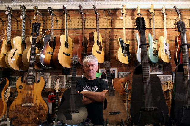 Rick Kelly, owner of Carmine Street Guitars, poses for a picture at his shop in New York City, U.S., July 21, 2016. (Photo by Joe Penney/Reuters)