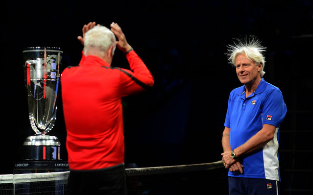 Swedish Bjorn Borg, captain of Team Europe and US John Mcenroe, captain of Team World react during the line up at the start at the start of the first day of Laver Cup on September 22, 2017 in O2 Arena in Prague. (Photo by Michal Cizek/AFP Photo)