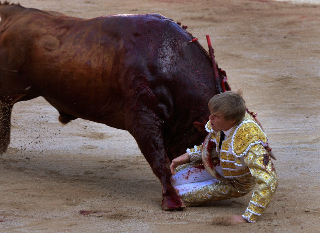 Spanish bullfighter Javier Jimenez is attacked by a bull during a bullfight at the San Fermin festival in Pamplona, July 2016. (Photo by Vincent West/Reuters)