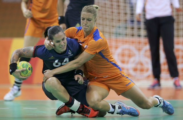 2016 Rio Olympics, Handball, Preliminary, Women's Preliminary Group B Netherlands vs France, Future Arena, Rio de Janeiro, Brazil on August 6, 2016. Alexandra Lacrabere (FRA) of France and Nycke Groot (NED) of Netherlands in action. (Photo by Marko Djurica/Reuters)