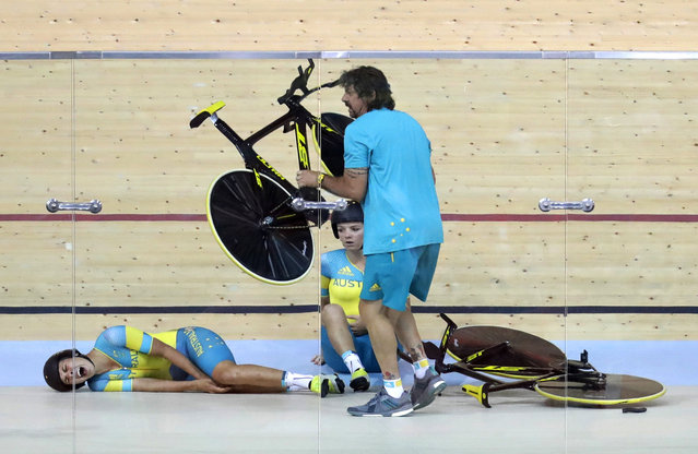 Melissa Hoskins, left, of the Australian women's track cycling team, reacts after crashing during a training session inside the Rio Olympic Velodrome during the 2016 Olympic Games in Rio de Janeiro, Brazil, Monday, August 8, 2016. (Photo by Patrick Semansky/AP Photo)