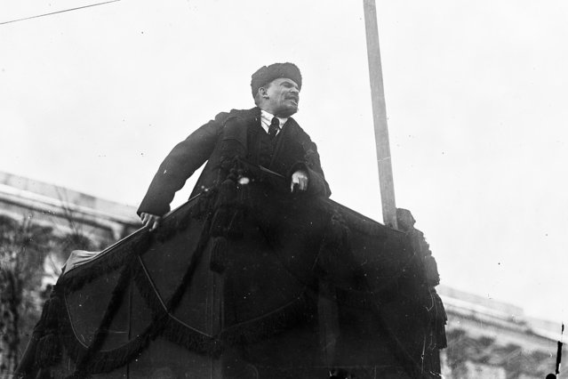 In this photo taken in November 7, 1918, provided by Russian State Archive of Social and Political History, Soviet leader Vladimir Lenin addresses a crowd during the first year of Revolution in Red Square in Moscow, Russia. The Kremlin is avoiding any official commemoration of the centennial of the 1917 revolution, tip-toeing around the event that remains polarizing for many, as the historic wounds of the revolution have not healed for the descendants of the event. (Photo by Russian State Archive of Social and Political History via AP Photo)