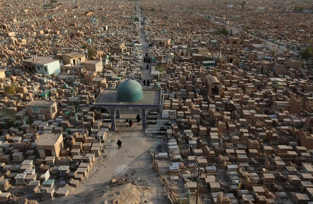 "The Wadi al-Salam cemetery, Arabic for ""Peace Valley"", is seen in Najaf, south of Baghdad, Iraq August 3, 2016. The world's largest cemetery, in Iraq's Shi'ite holy city of Najaf, is expanding at double its usual rate as Shi'ite militias bury their dead from the war against Islamic State. The Wadi al-Salam cemetery, Arabic for ""Peace Valley"" has a special place in the hearts of Shi'ite Muslims as it surrounds the Mausoleum of their first imam, Ali Bin Abi Talib, a cousin and son-in-law of Prophet Mohammad. (Photo by Alaa Al-Marjani/Reuters)"