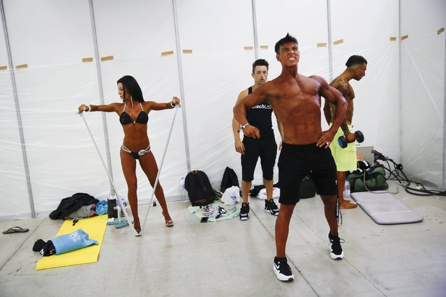 Competitors warm up backstage during the Arnold Classic Europe bodybuilding event in Madrid, Spain, September 25, 2015. (Photo by Susana Vera/Reuters)